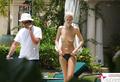 Claudia Schiffer - topless sunbathing (2002)